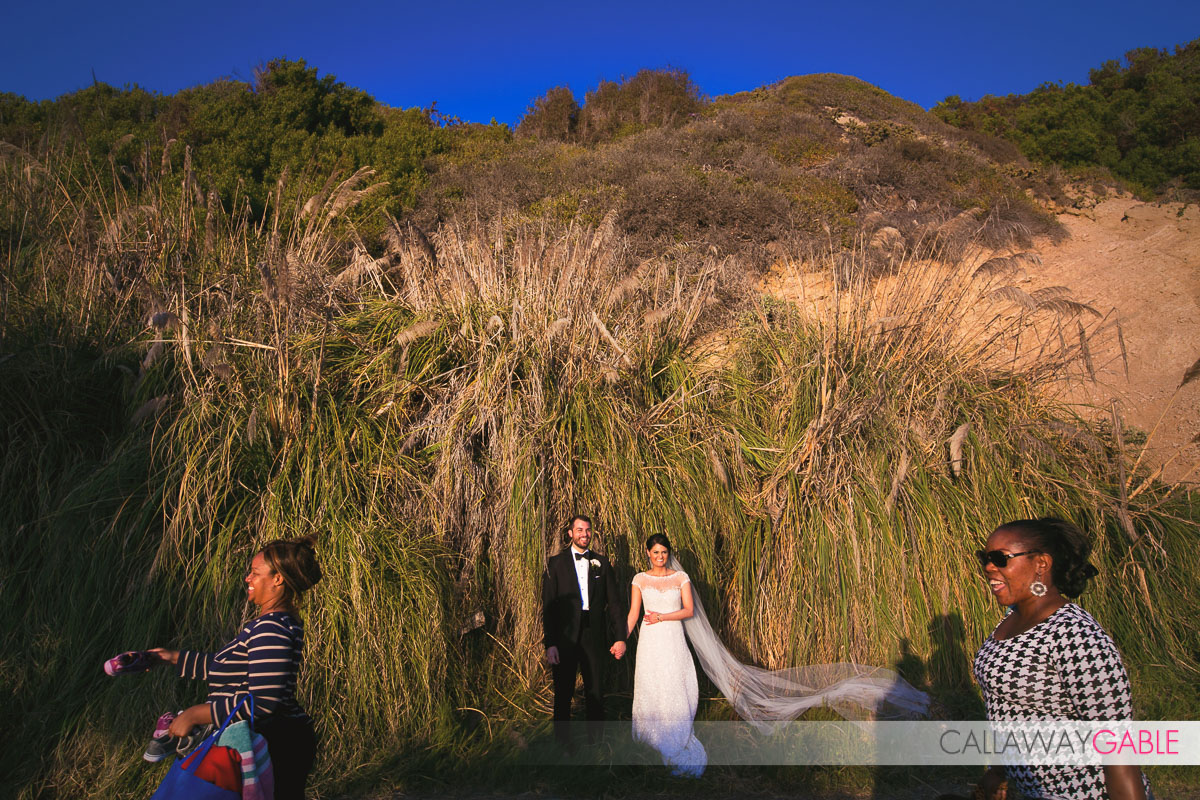 Funny wedding photo on the beach in Laguna Niguel