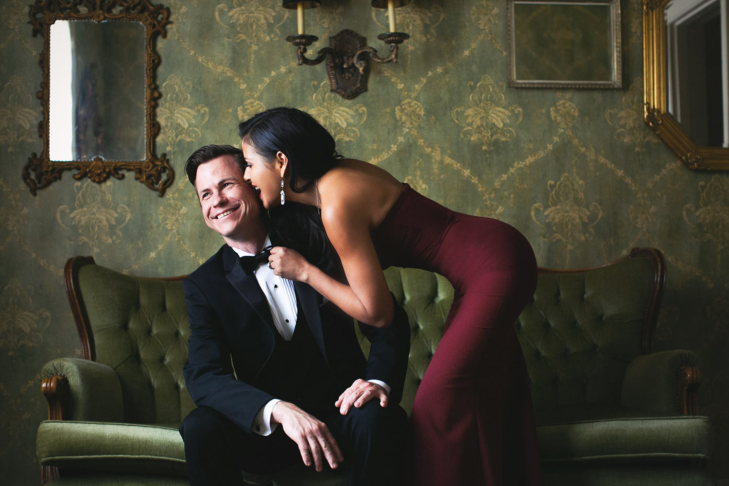 Sexy engagement photo at the Ebell of Long Beach of bride grabbing groom's tie