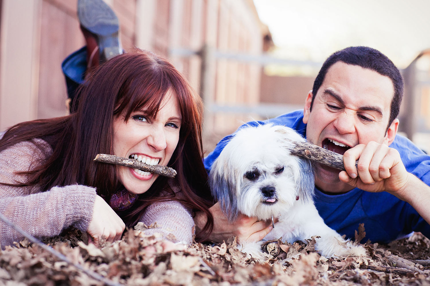 Cute Los Angeles engagement photo of couple playing with their dog