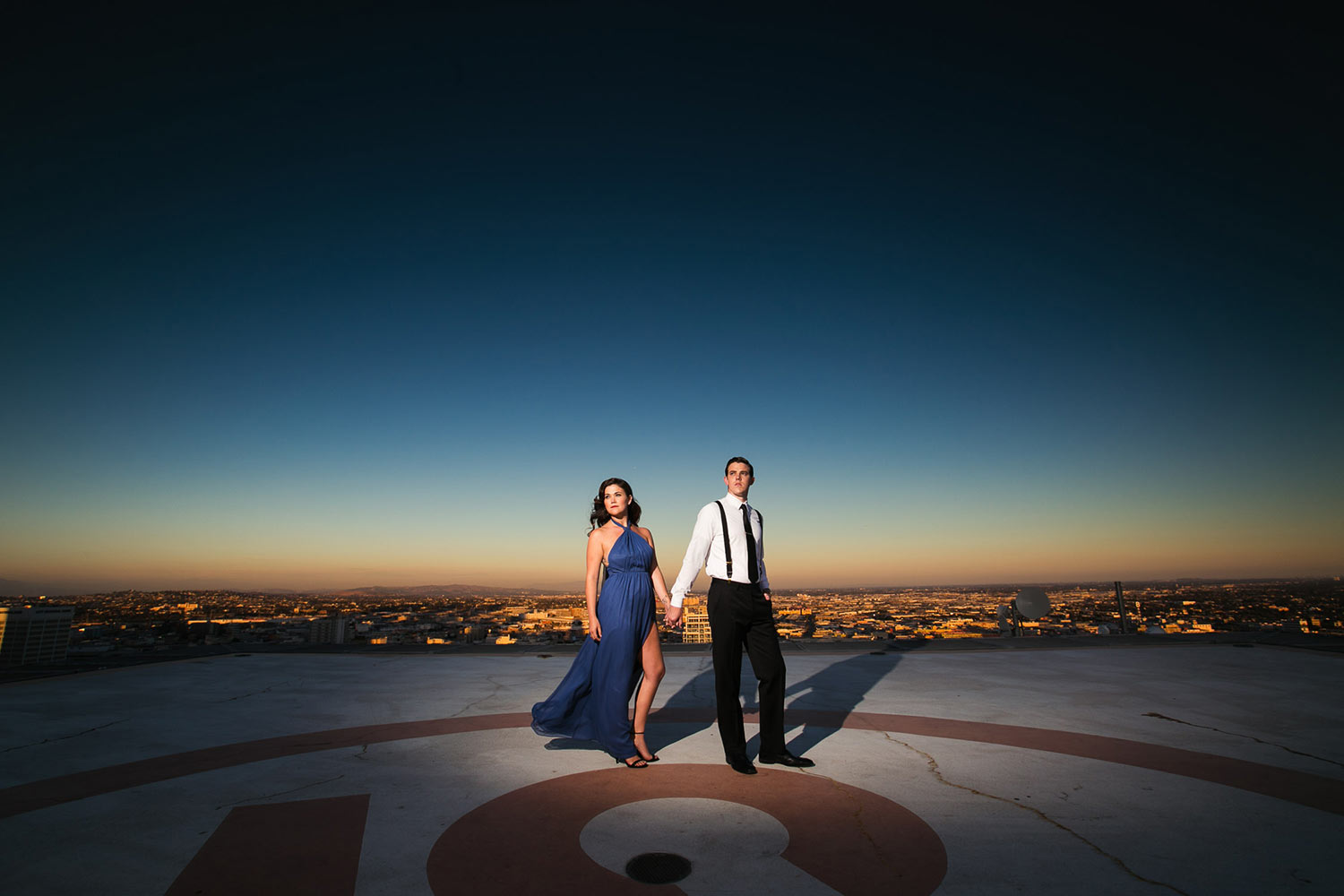 Fashion-inspired Downtown Los Angeles Engagement photo on a helicopter pad