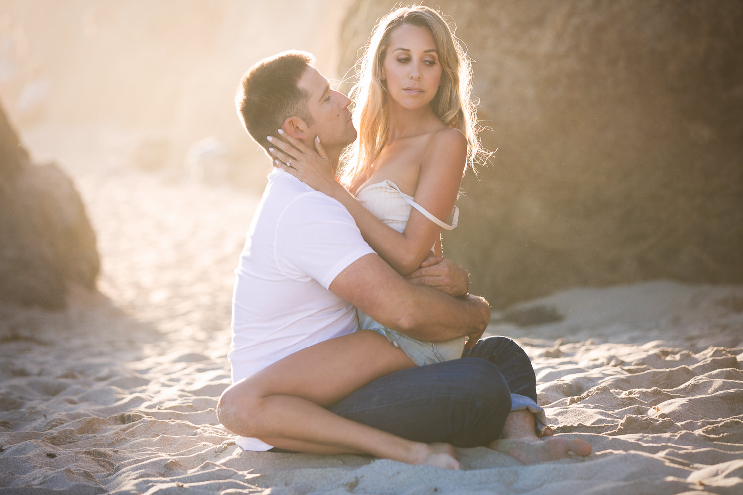 Hot El Matador State Beach Engagement photo of bride sitting on groom in the sand