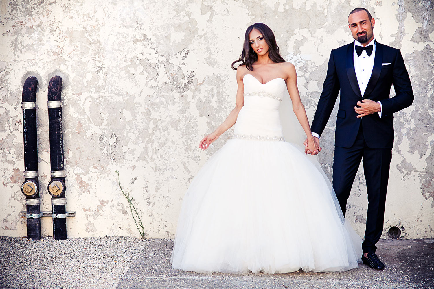 Fashion wedding at Vibiana in downtown Los Angeles - Persian Groom and Bride wearing couture gown and tuxedo