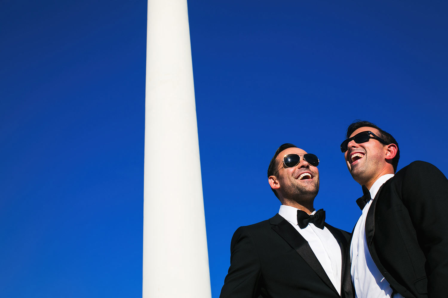 Same Sex Mens Wedding in Palm Springs wearing black tuxedos