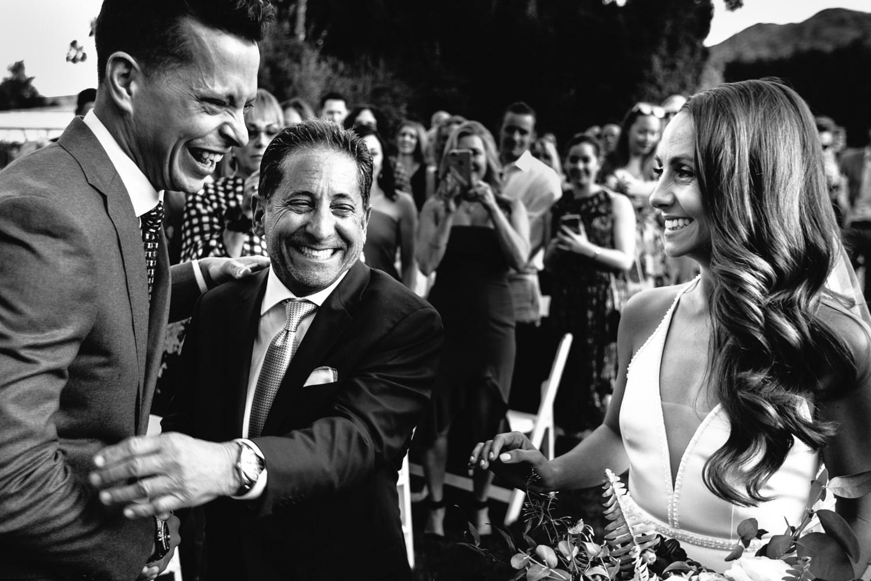 Brides Dad Hugs Groom At Their Palm Springs Wedding