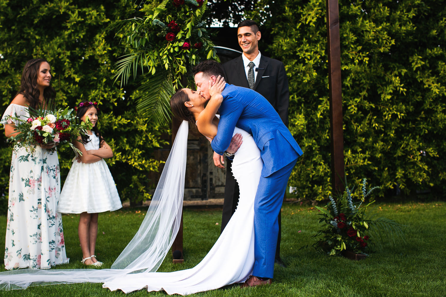 Kissing the bride at their Parker Wedding