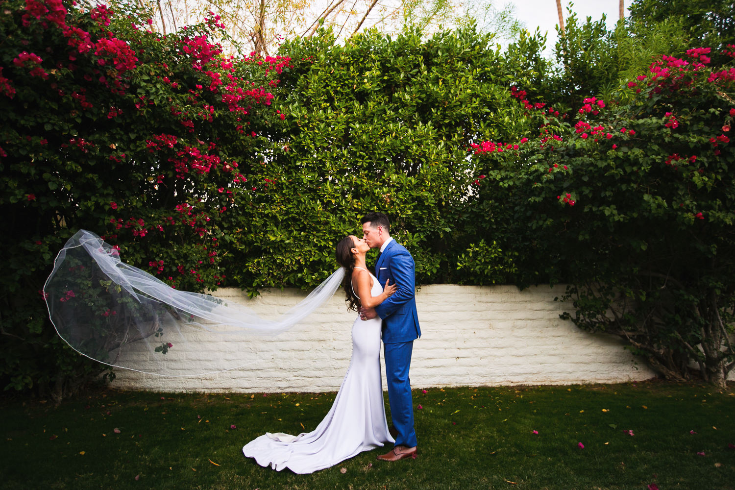 Great photo of newly weds kissing in the garden of their Parker Palm Springs wedding