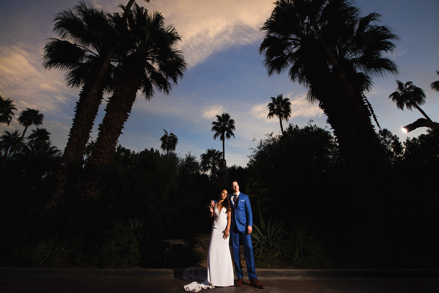 Parker Palm Springs wedding stunning sky backdrop with newly weds