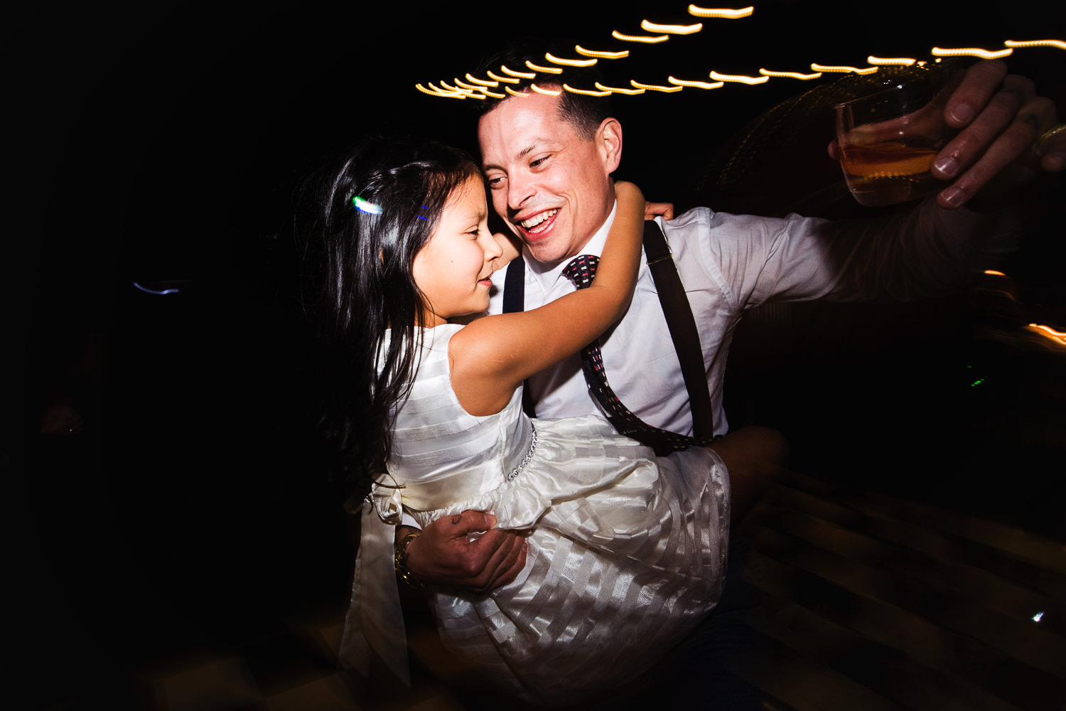 Groom dancing with child at his Palm Springs Wedding