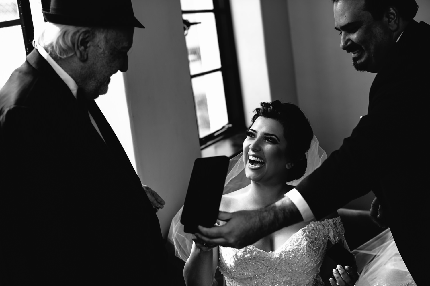 Vibiana Wedding Photographs of Bride receiving gift from her husband