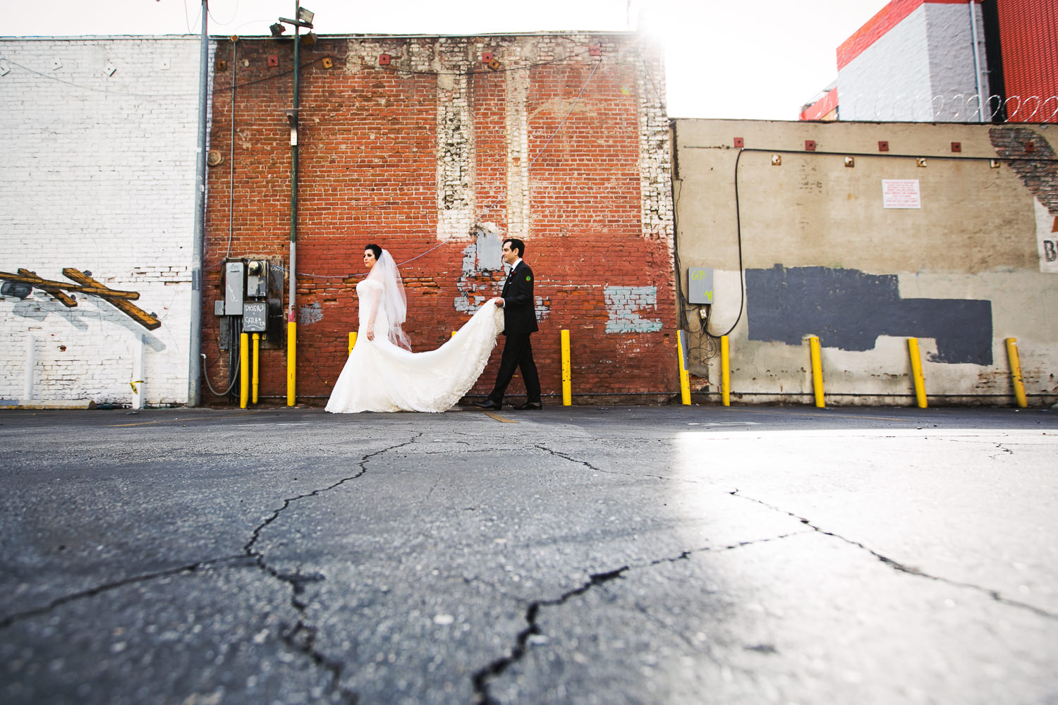Awesome Vibiana Wedding Photographs of Bride and Groom outside the front doors
