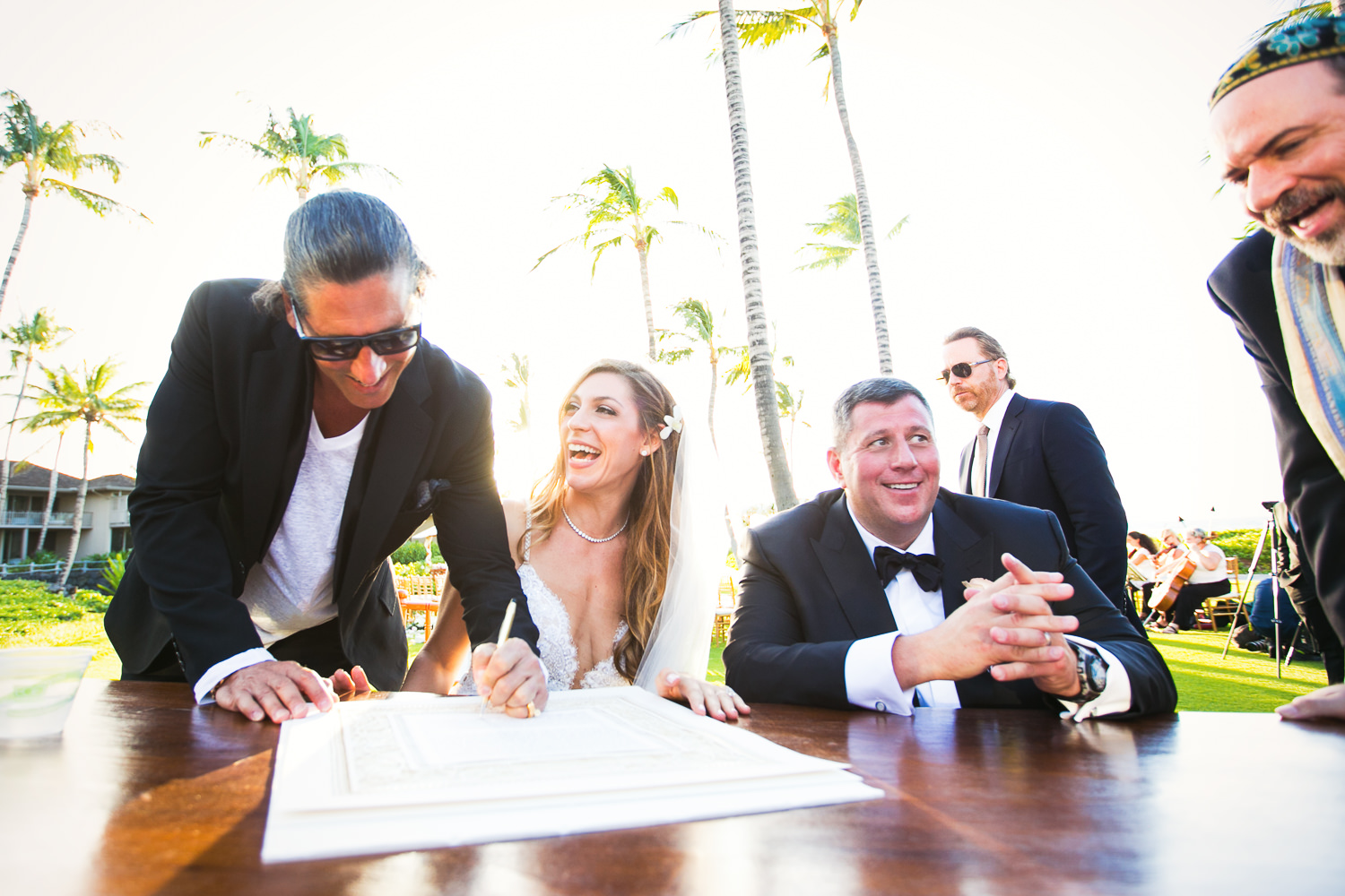 Signing the ketubah at a Outdoor Wedding Ceremony at the Four S