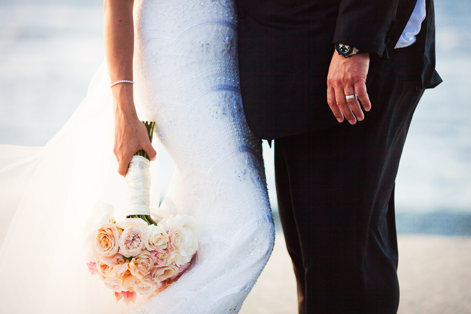 Her bouquet and his arm at the Four Seasons Hualalai by Big Island wedding photographer Callaway Gable