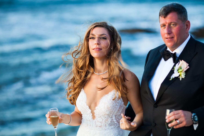 Walking on the beach at the Four Seasons Hualalai by Big Island wedding photographer Callaway Gable