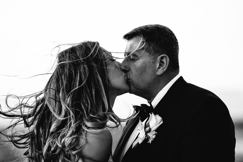 A kiss on the beach at the Four Seasons Hualalai by Big Island wedding photographer Callaway Gable