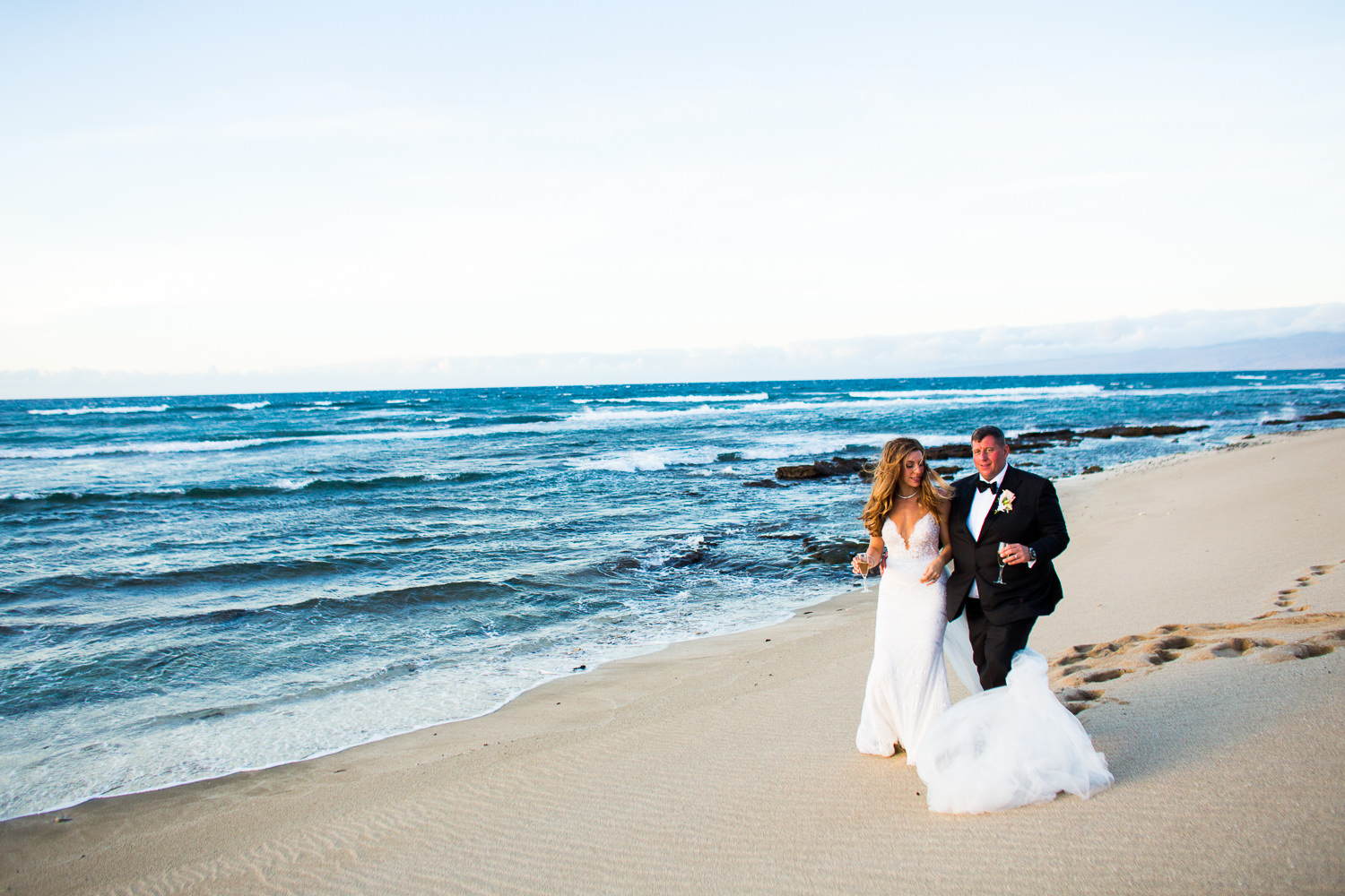 Walking down the gorgeous beach at the Four Seasons Hualalai by Big Island wedding photographer Callaway Gable