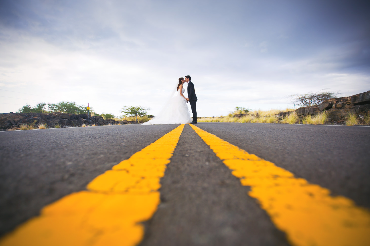 Wedding Portrait of Bride and groom on the road in Kona on Big Island