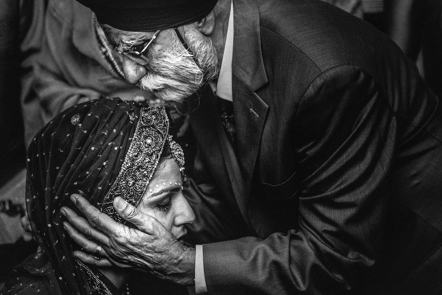 Emotional moment of bride with her grandfather at her Hyatt Regency Huntington Beach Indian Wedding