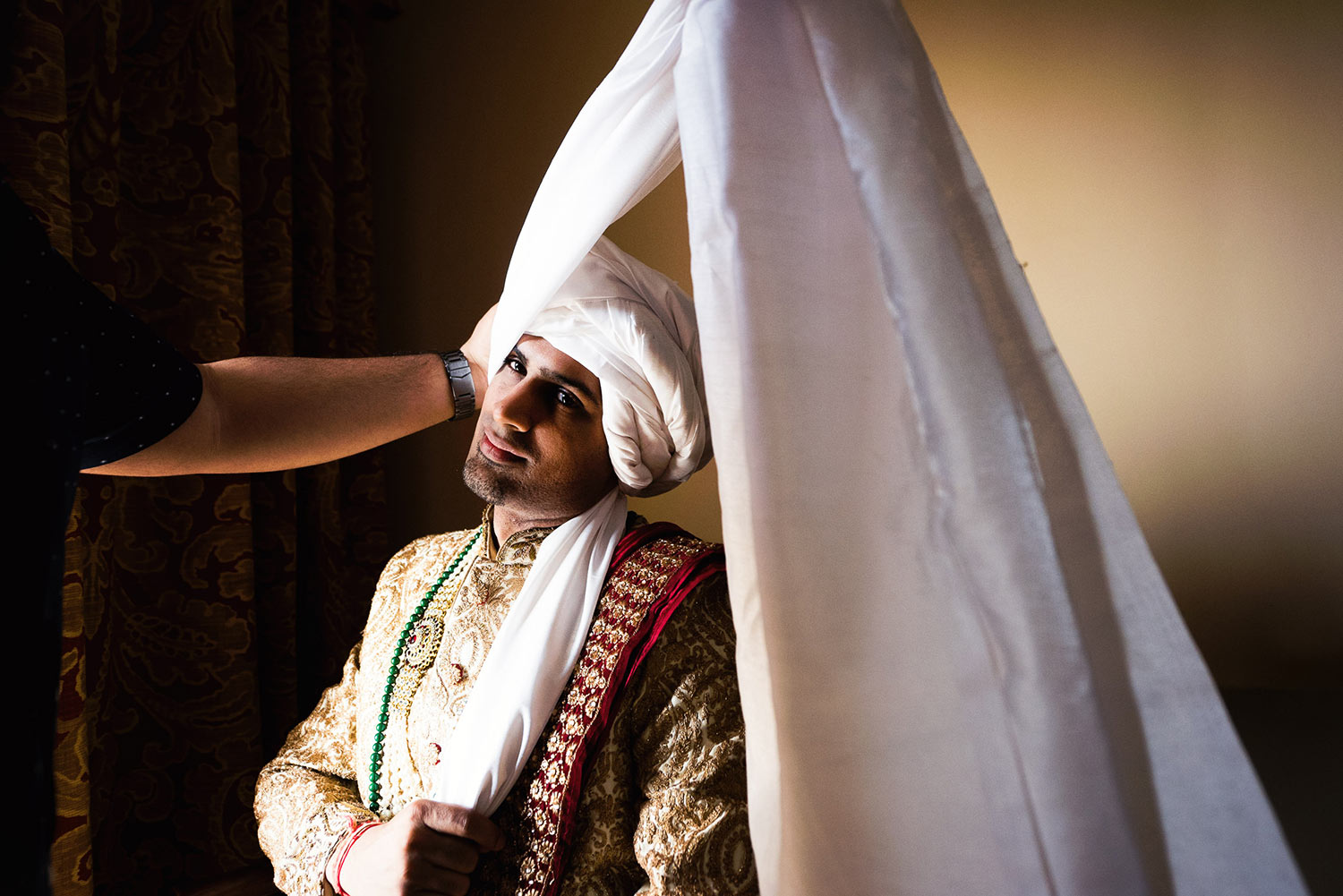 Langham Pasadena Indian Groom getting his turban on