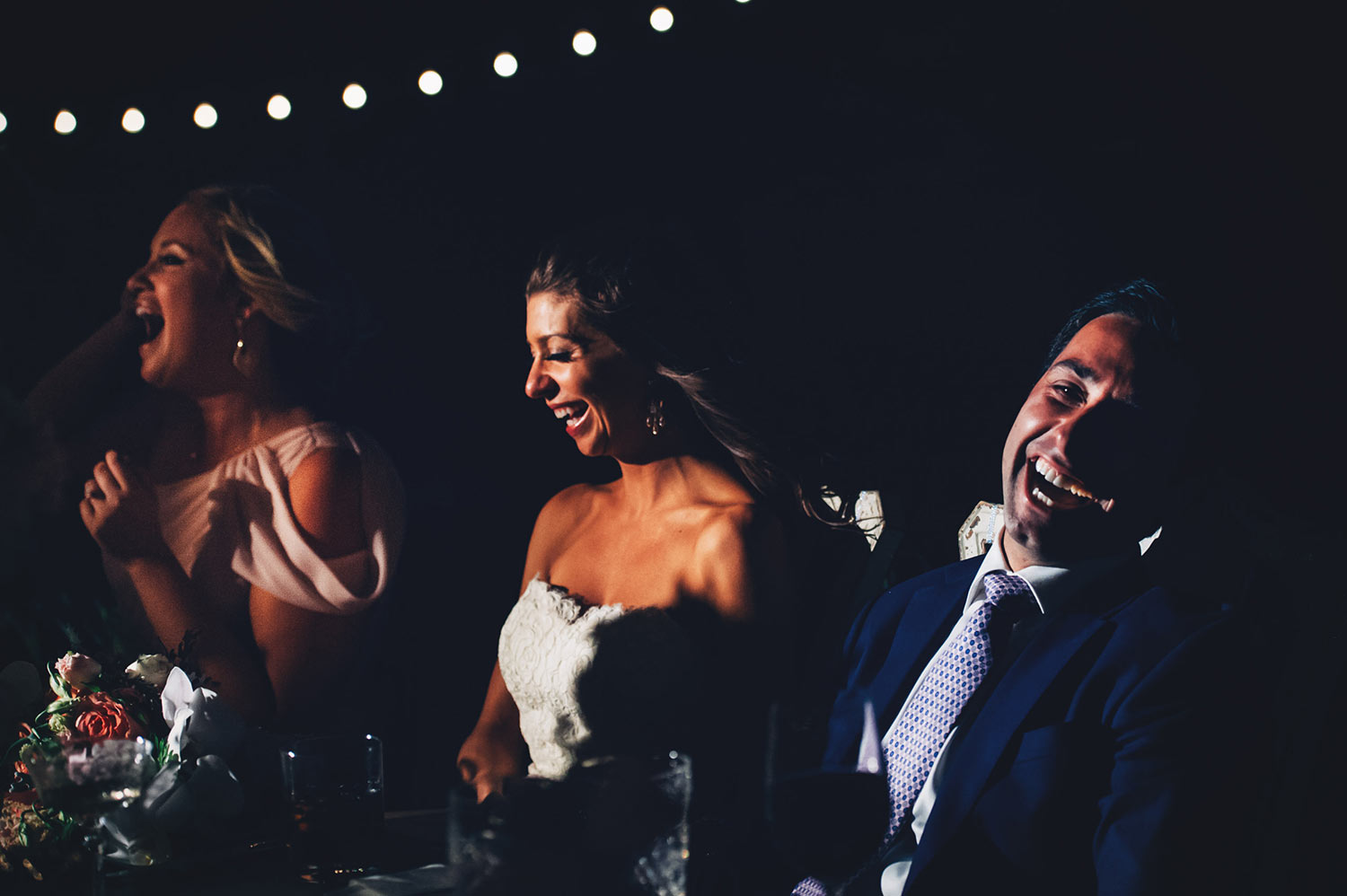 Great Los Angeles reception moment of bride and groom laughing during speeches