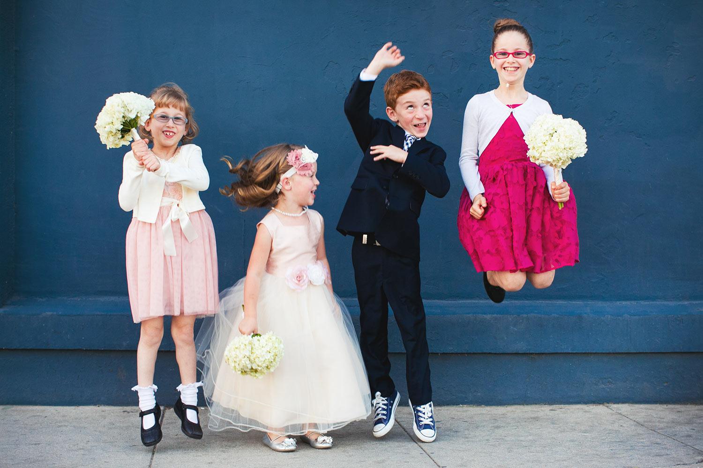 Kids at a Los Angeles wedding jumping and having fun