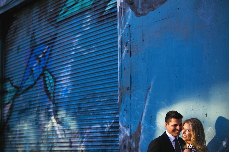 Colorful Couples Arts District Engagement Embrace