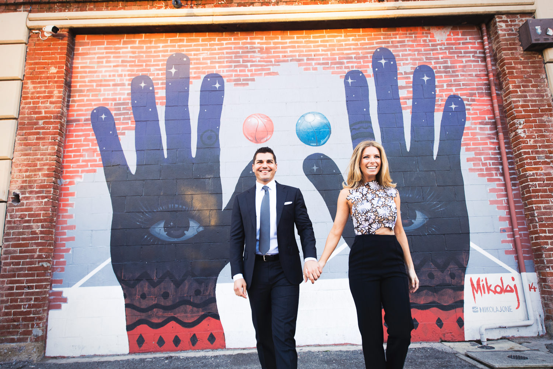 Cute Couple Arts District Engagement Holding Hands