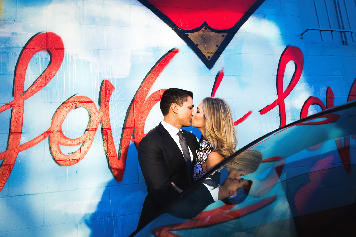 Cute Couple Embrace At Their Arts District Engagement