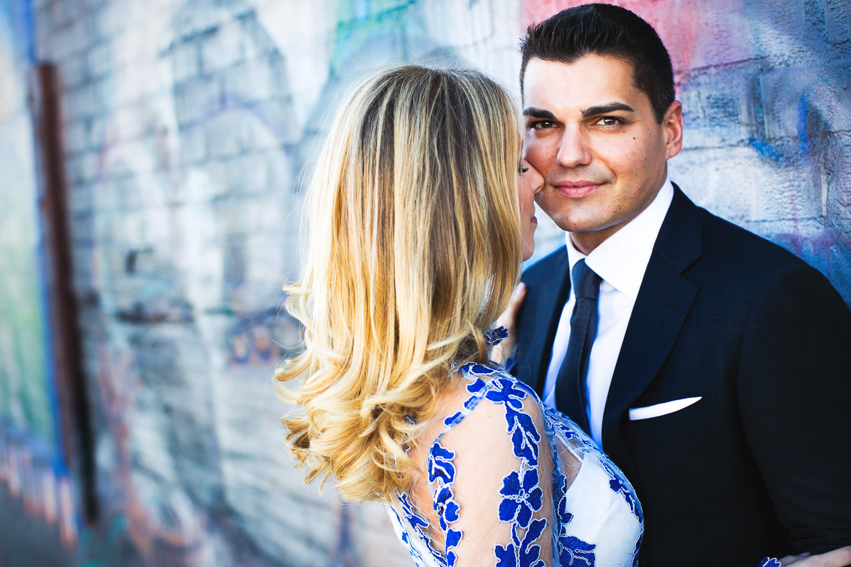 Fashionable Arts District Engagement Couple Embracing