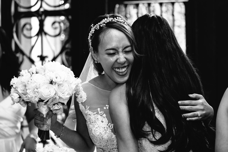 Vibiana Wedding Venue - Bride Hugging Bridesmaid
