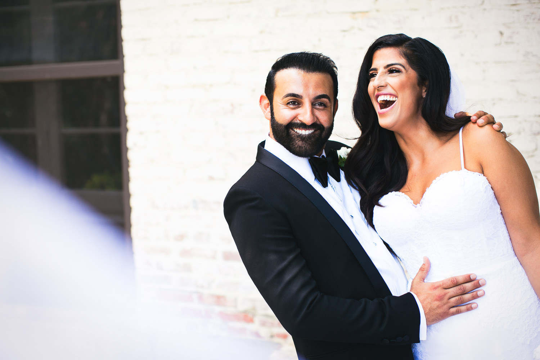 Hummingbird Nest Ranch Wedding - Persian Bride & Groom Laughing