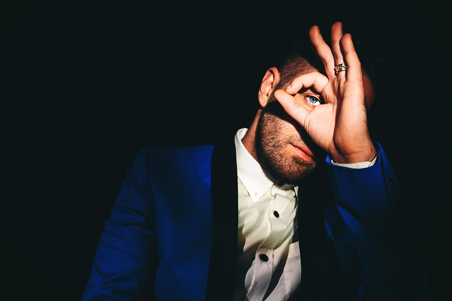 Photo of Los Angeles Groom in dark blue tuxedo