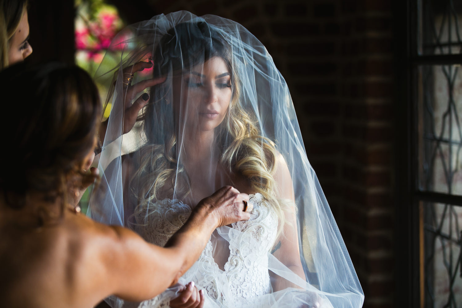 Bride getting ready at the pool house at Hummingbird Nest wedding by Callaway Gable