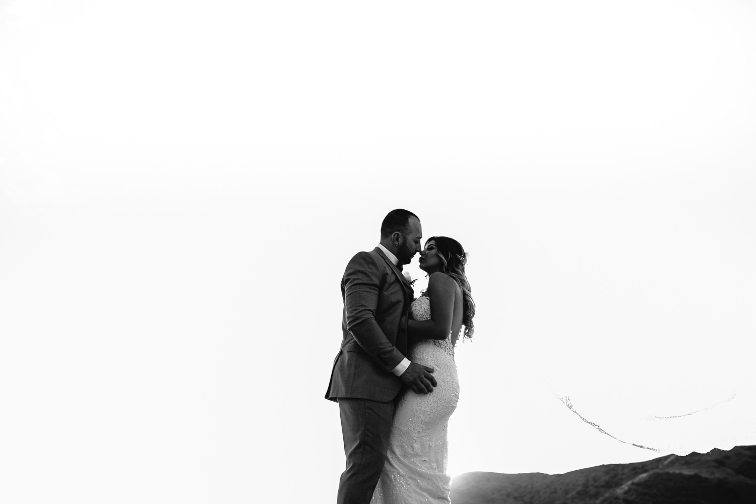 Standing on the rocks at Hummingbird Nest wedding by Callaway Gable