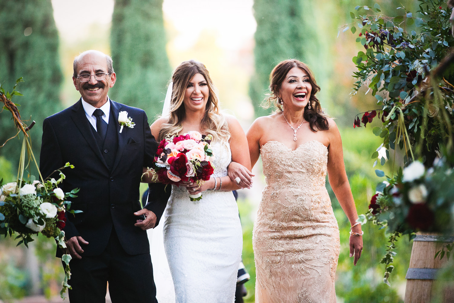 walking down the aisle in the olive garden at Hummingbird Nest wedding by Callaway Gable