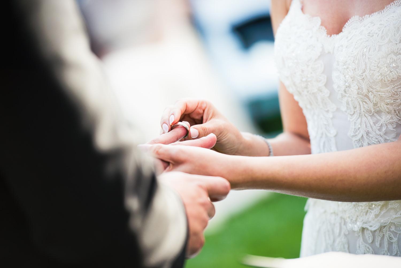 Four Seasons Santa Barbara Wedding - Bride Putting Ring On Groom