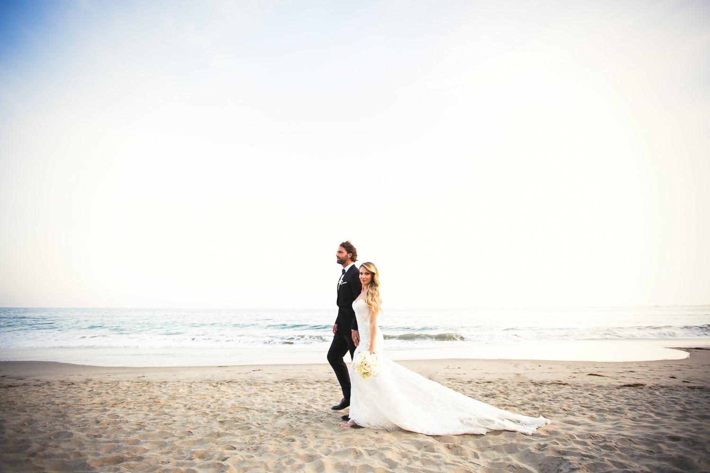 Four Seasons Santa Barbara Wedding - Hand in Hand on the Beach