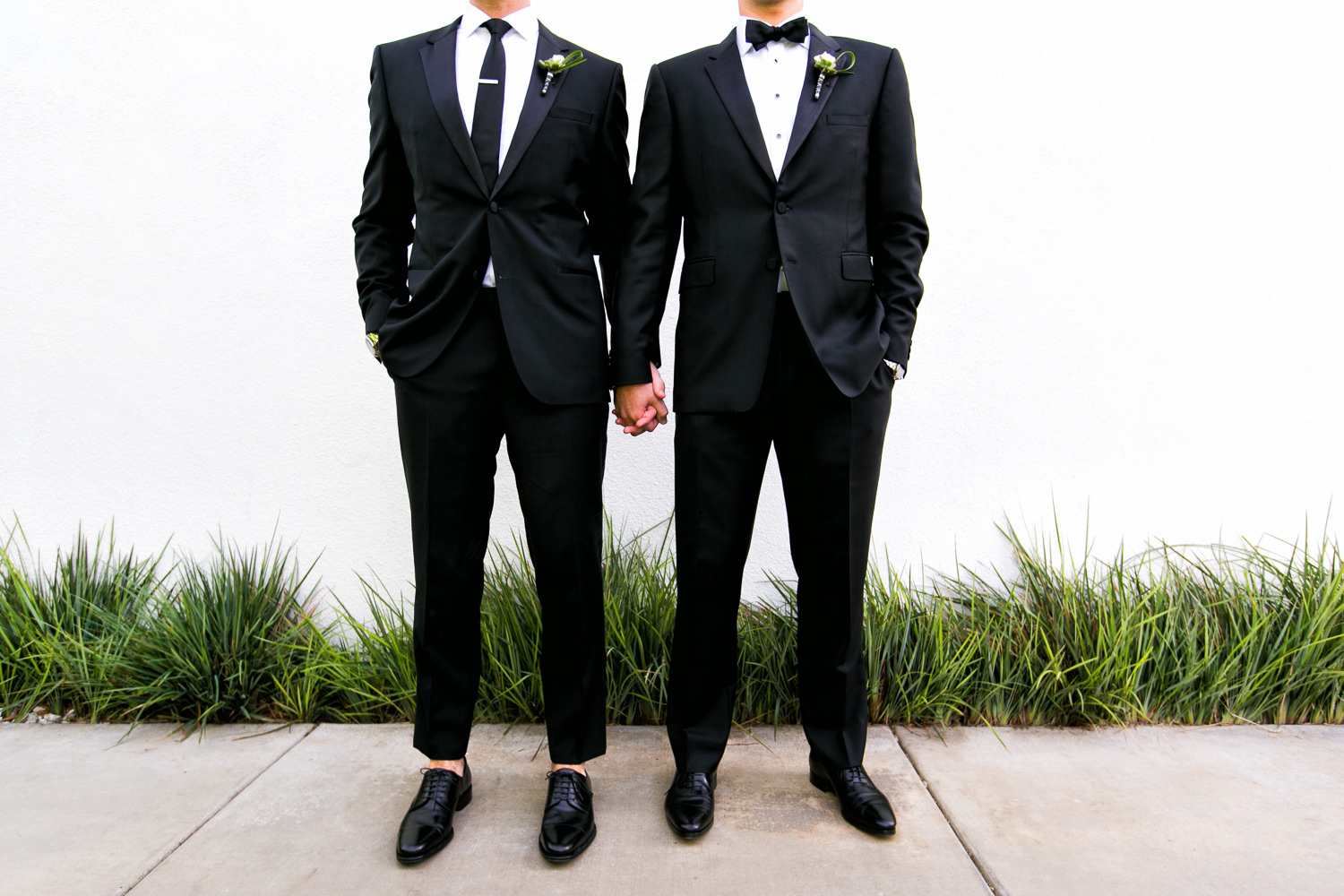 Same Sex Avalon Palm Springs Wedding - Great Suits Together Holding Hands