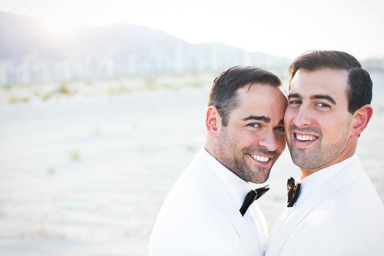 Same Sex Avalon Palm Springs Wedding - Embracing Before Reception