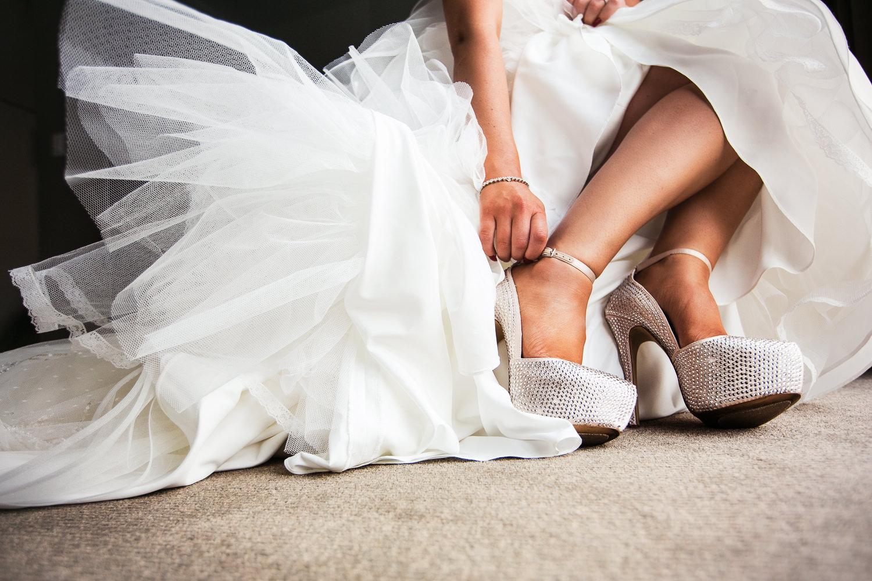 SLS Beverly Hills Wedding - Bride Putting On Shoes