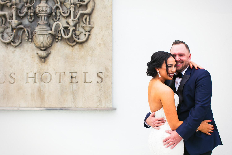 SLS Beverly Hills Wedding - Bride & Groom Embrace Before Ceremony