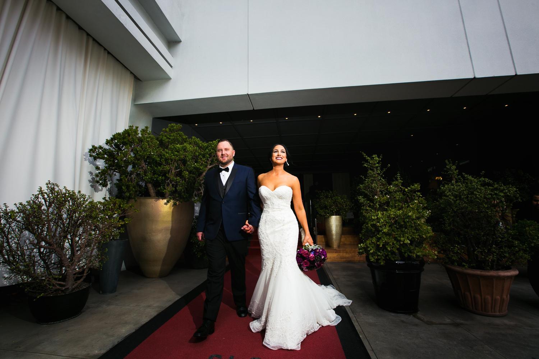 SLS Beverly Hills Wedding - Bride and Groom Walking Hand in Hand
