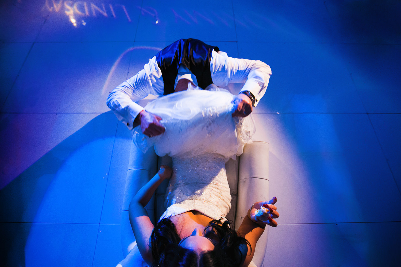 SLS Beverly Hills Wedding - Groom Diving Under Brides Dress