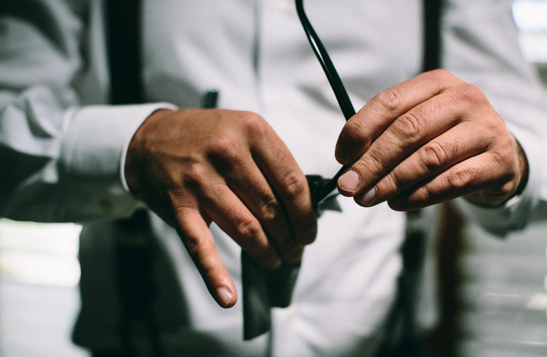 Los Olivos Wedding - Groom Cleaning His Sunglasses