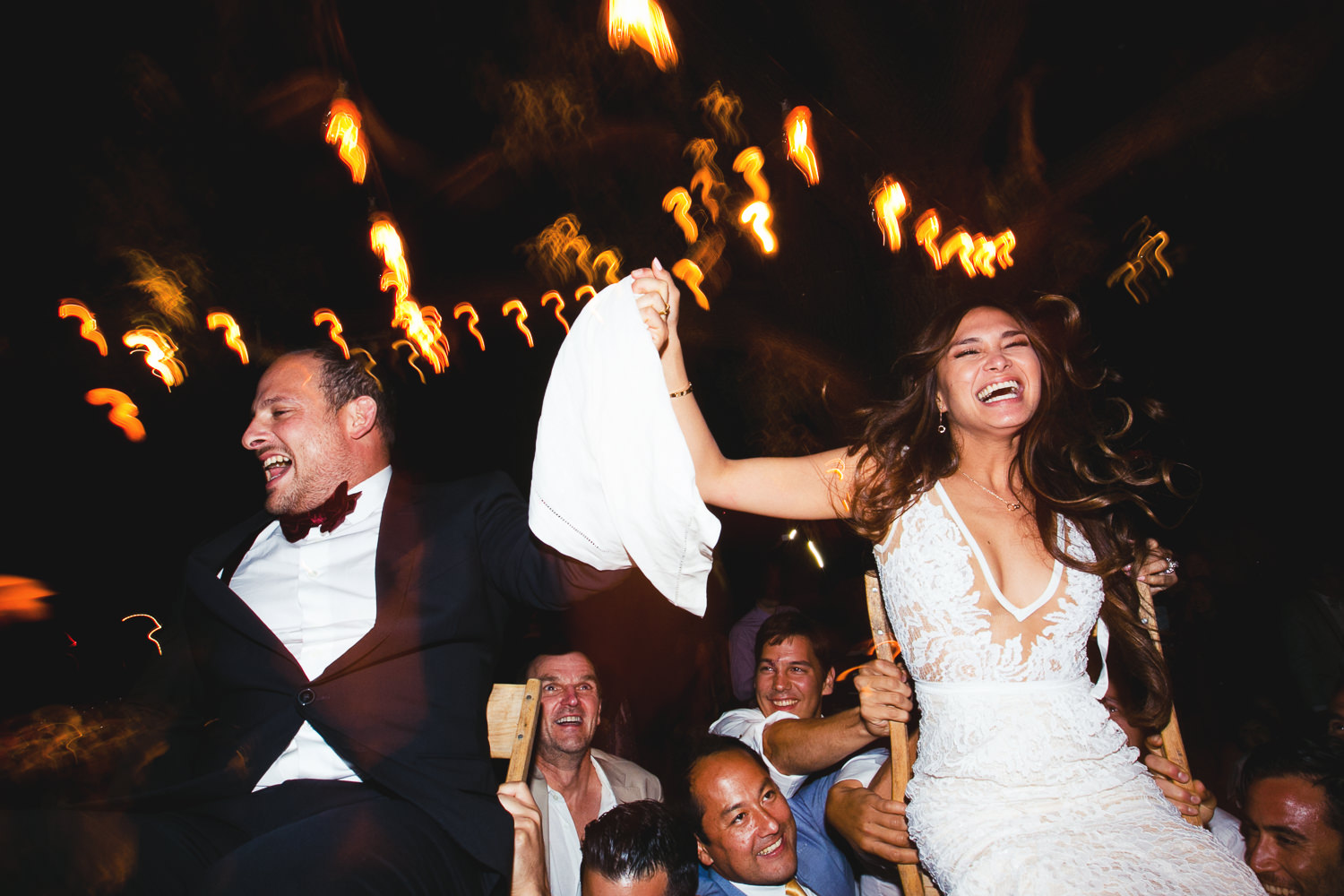 Los Olivos Wedding - Newly Weds Being Hoisted Up By Guests at Wedding Reception