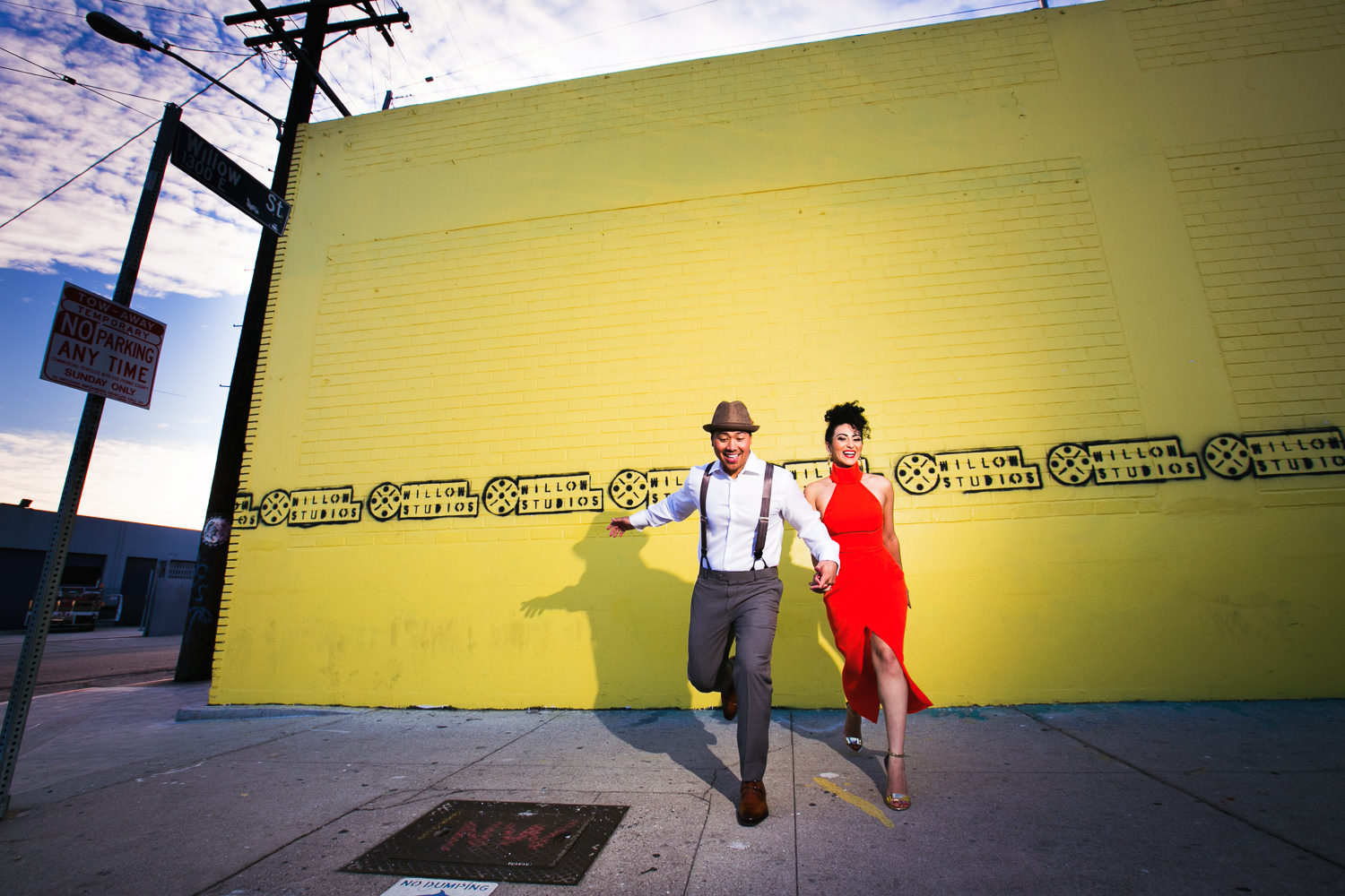 Fashionable Engagement in Downtown Los Angeles - Hand in Hand and Dancing