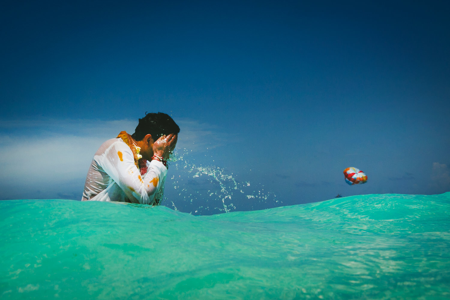 Paradisus Cancun Indian Wedding - Groom in the ocean