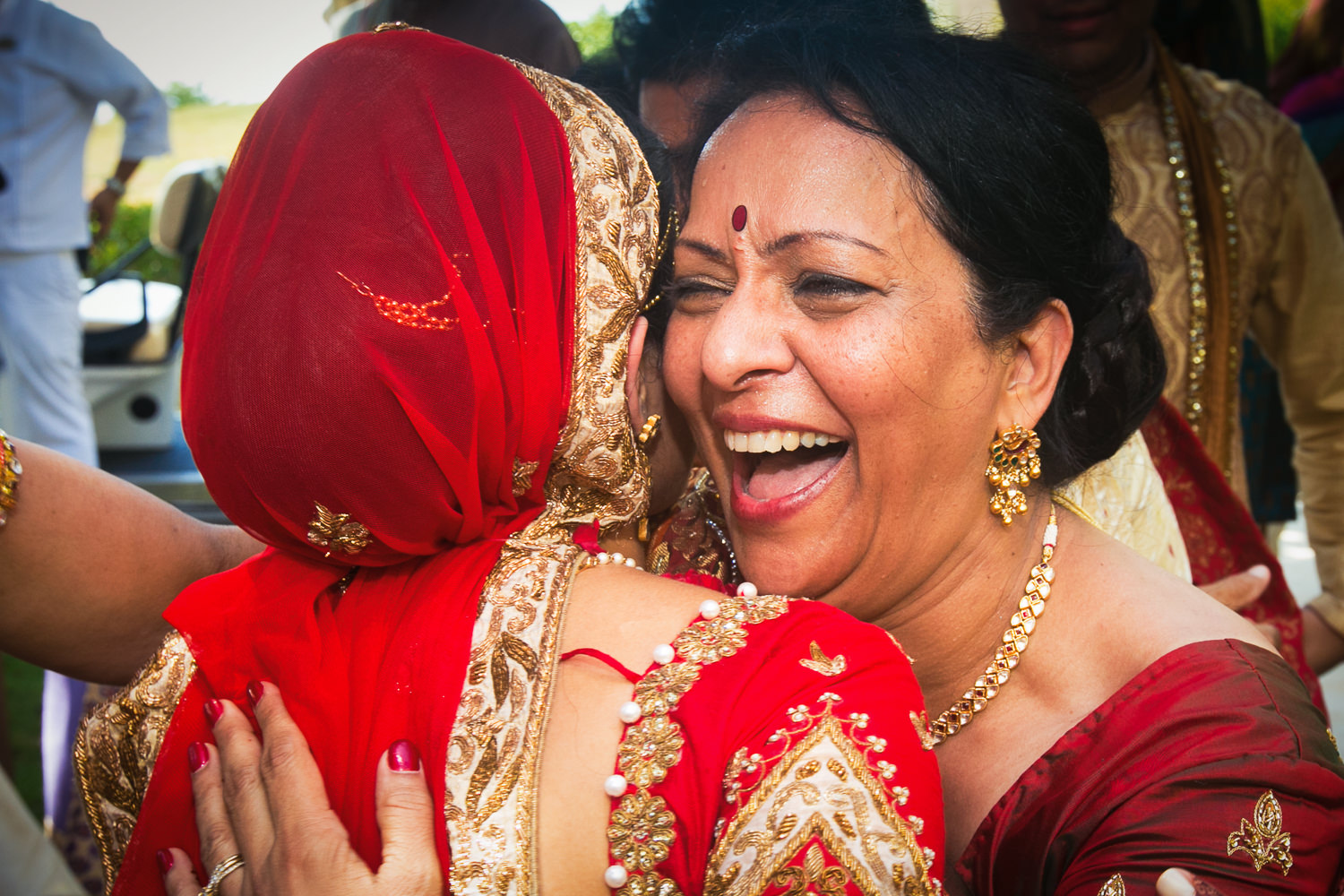 Paradisus Cancun Indian Wedding - Mom Hugging Bride