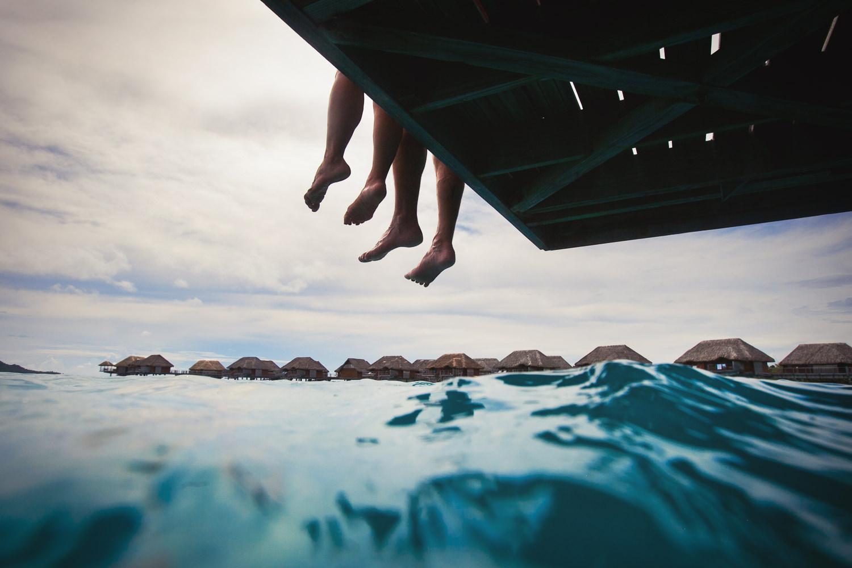 Four Seasons Bora Bora Wedding - Feet hanging off the dock