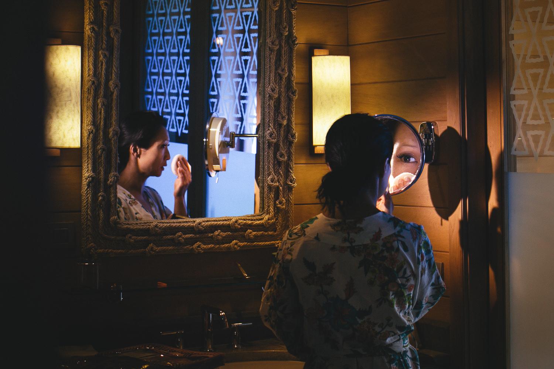 Four Seasons Bora Bora Wedding - Bride putting on makeup