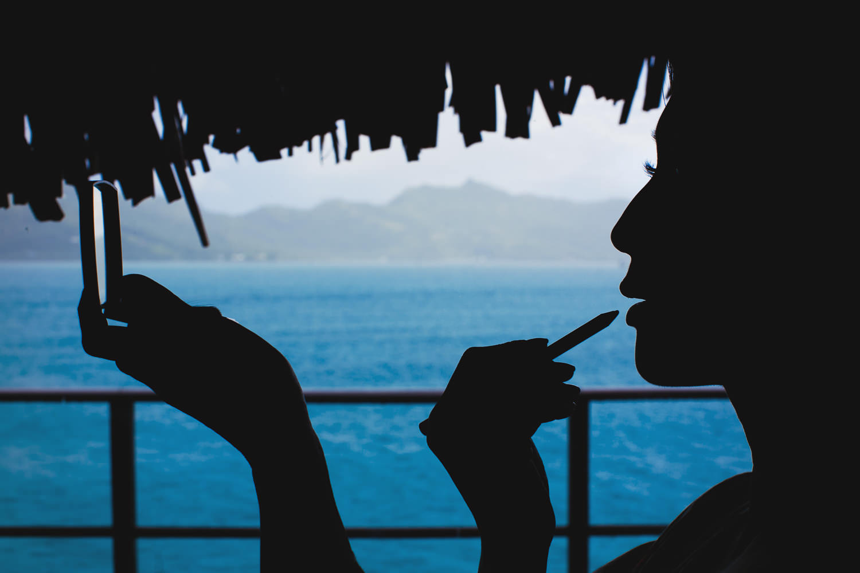 Four Seasons Bora Bora Wedding - Adjusting makeup by the water